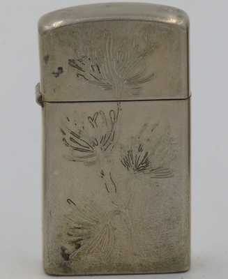 1957 slim prototype Sterling Zippo with a floral design