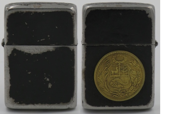 1942-45 Black Crackle Zippo with a Peruvian 1 Sol coin
