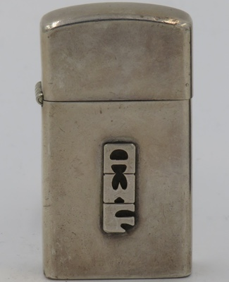 "1960 slim  Sterling Zippo with letter ""AWF"" attached"