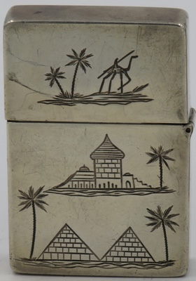 Unmarked Sterling lighter with engravings of Egyptian pyramids, buildings, palm trees and camel
