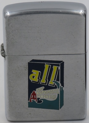 "1960 Zippo with a colorful box of the detergent ""All - For Automatic Washers"".  All is a product of Unilever, one of the world's leading producers of household products"