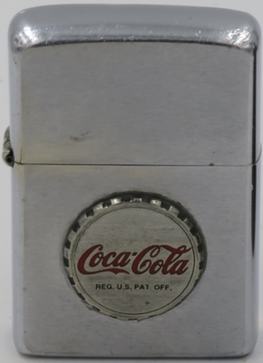 1970 with an attached Coca-Cola bottle cap badge.