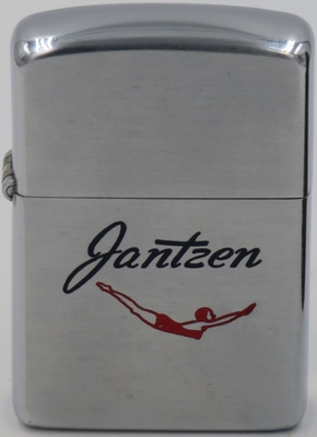 "1954 Zippo for Jantzen, a brand of swimwear that was established in 1916. The brand featured a logo image of a young woman, dressed in a red one-piece swimsuit and bathing hat, assuming a diving posture with outstretched arms and an arched back. Known as the Jantzen ""Diving Girl"", the image in various forms became famous throughout the world during the early twentieth century"