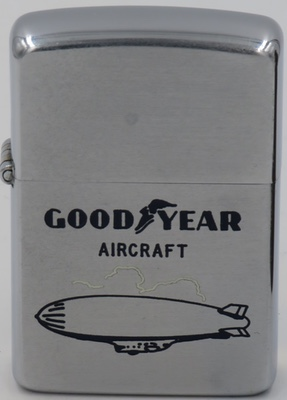 1954 Zippo with a graphic of the Goodyear blimp.  Goodyear Aerospace Corporation was the aerospace and defense subsidiary of Goodyear. The company was originally operated as a division within Goodyear as part of a joint project with Luftschiffbau Zeppelin, leading to the famous Goodyear Blimps.