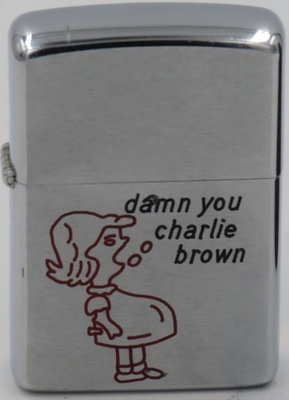 "1968 Zippo with a graphic of a pregnant Lucy shouting ""Damn you Charlie Brown"".  It is unlikely that this lighter was engraved at the factory of Zippo Mfg. Co."