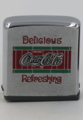 Tape measures were introduced by Zippo Mfg. C.in 1962.  This tape measure has Coca-Cola's Delicious & Refreshing designs introduced in 1904