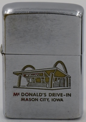 "1962 Zippo with a McDonald's Drive-In in Mason City, Iowa is similar to the lighters to the left but for missing paint and the ""McDonald's Drive-In"" spelled out"