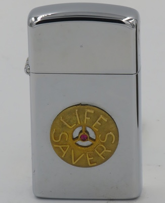 1977 slim Zippo with an attached badge for Life Savers. First marketed in 1912, Life Savers is a traditional American brand of hard candy. The multi-flavored ring shaped candies are packaged in rolls