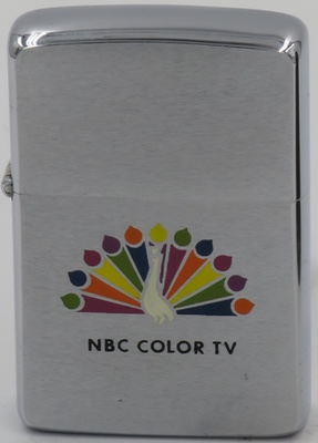 "1965 Zippo with the NBC Color TV peacock.  The NBC Peacock is one of the most well-known logos in since 1957 when color television was ""brought to you in living color"" by the peacock"