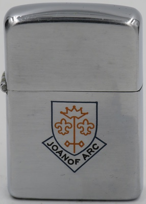 1955 Zippo with an engraving of Joan of Arc's battle shield. The elements represent the Crown of Heaven, her sword and two fleur-de-lis, representing the Angels of Justice and Mercy