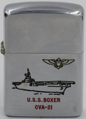 1953 Zippo with a graphic of USS Boxer, an amphibious assault ship of the United States Navy. She is the sixth U.S. Navy ship to bear the name, and was named for the original HMS Boxer, which had been captured from the British during the War of 1812.