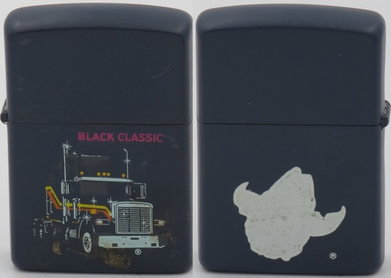 "c1993 Zippo with a matte dark blue finish with prototype designs for the Zippo Souvenir Truck Series.  It has the Black Classic truck image on the front and the outline in white of the ""Born Bad"" design from the same series"