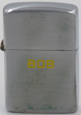 """1947 test model Zippo with """"Bob"""" engraved in yellow. It is by or for Bob Holzinger, Zippo Mfg.Co's plant manager"""