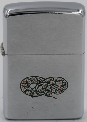 Rare 1966 prototype Zippo Rattlesnake lighter, the snake is an artwork error. The rattlesnake's tail is pointed down when the tail should have been pointing up