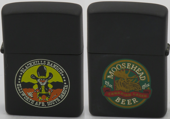 1985 prototype Zippo with a logo of Blackhill Bandits for the 44th Strategic Missile Wing, Ellsworth AFB, South Dakota which was inactivated in 1994.  The reverse has a logo for Moosehead Beer, Canada's oldest independent brewery, located in Saint John, New Brunswick