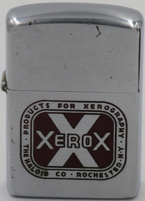 "1953 Zippo for ""Xerox - Products for Xerography - The Haloid Company, Rochester NY""  The photocopier was invented in 1938 by the Haloid Company, which eventually changed its name to Xerox.  This Zippo lighter pre-dates 1959 when Xerox introduced its  Xerox 914 model which revolutionized the document copying industry"
