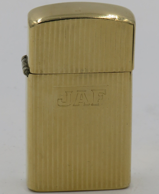 "c1953 14K gold slim Zippo with the initials ""JAF"""