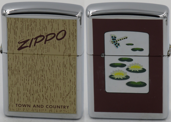2000 Zippo which is one in a series which are engraved with images of classic Zippos.,  The one show here replicates a T&C wood grain box and the lily pond image