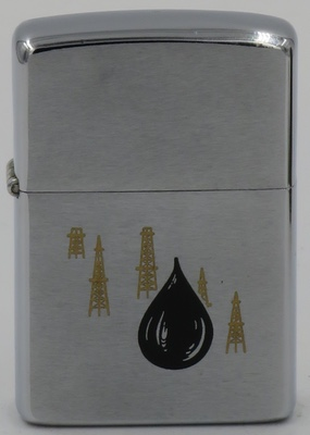 1973 Zippo with Oil Drop and images of drilling rigs in the background