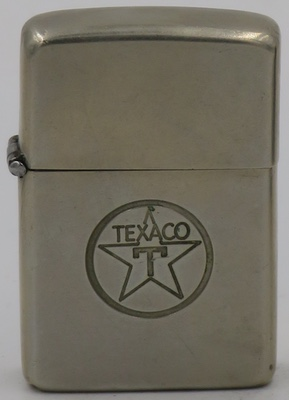 "Brass finish 1946-49 Zippo with a line-drawn Texaco ""star"" logo"
