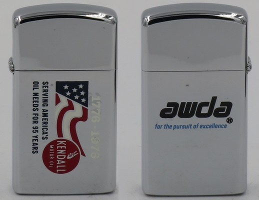 "1975 2-sided slim Zippo celebrating America's bicentennial, 1776-1976. Serving America's Oil needs for 95 Years. The reverse reads ""awda for the pursuit of excellence"" which is an award by the  Auto Care Association."