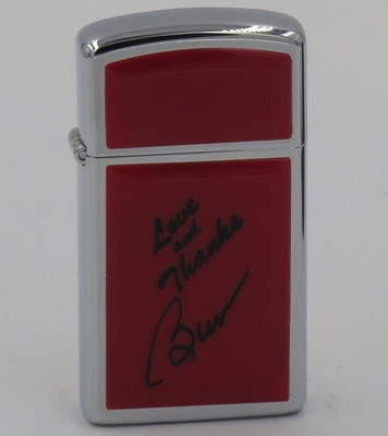 "1981 slim red Ultra Lite Zippo with ""Love & Thanks, Burt"" from Burt Reynolds, a top box office movie star"