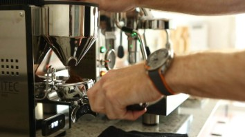 Home Barista Workflow - grinding coffee for home espresso with a traditional manual Italian coffee espresso machine