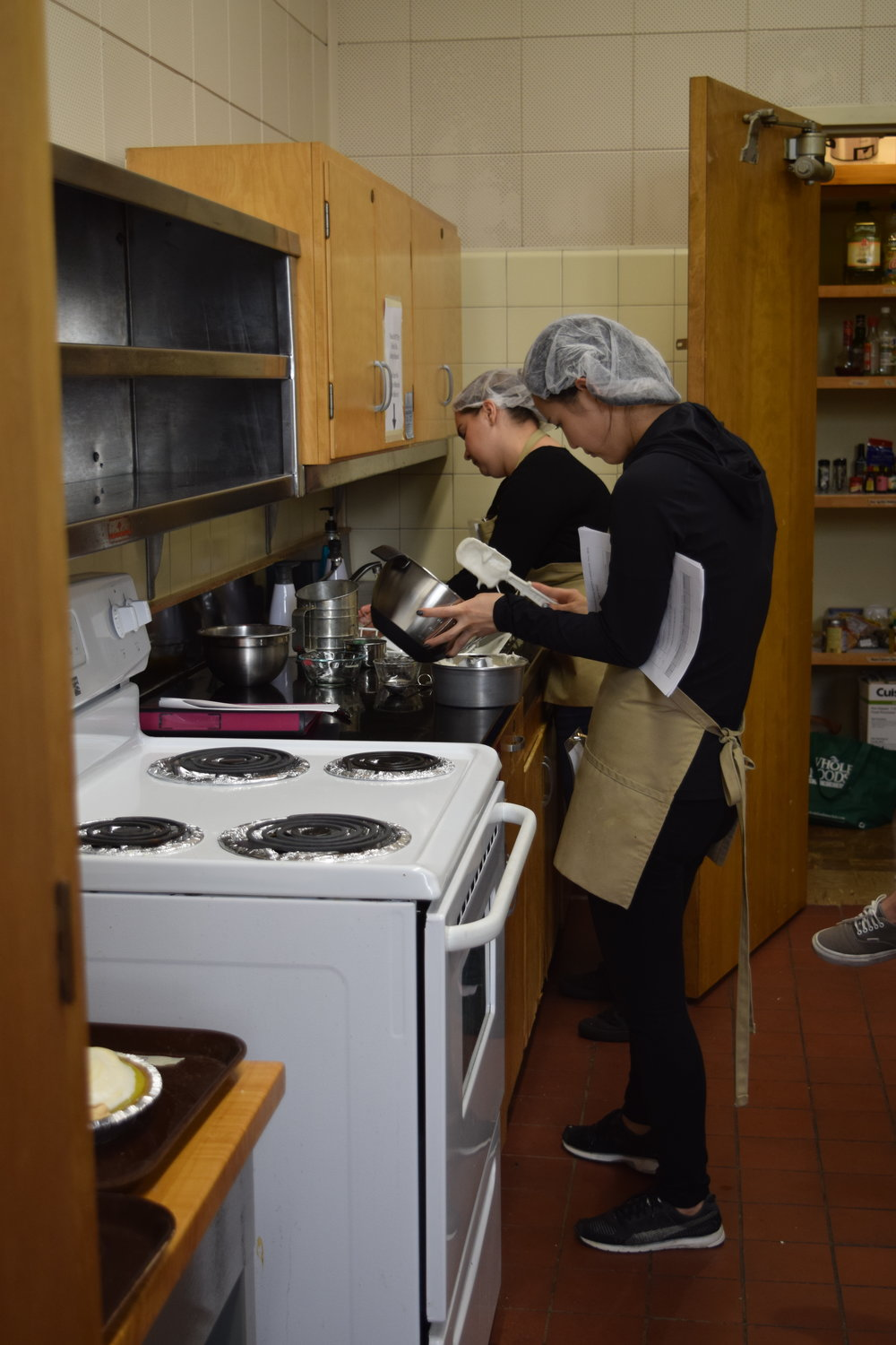 Photos are of the classroom and a cooking experience similar to NST 20.