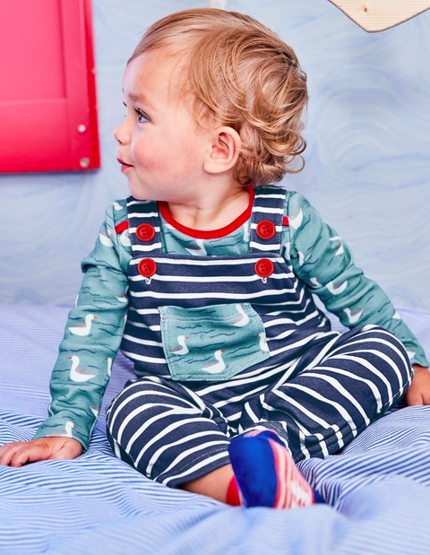 Baby in Boden dungarees and Seascape wallpaper