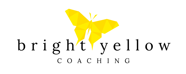 bright yellow coaching by tracy james logo