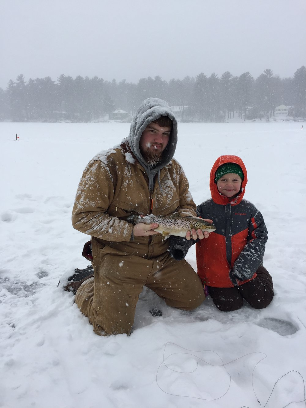 Caleb and Christopher Hill, with anonymous visitor, on Pettingill Pond, Windham, ME
