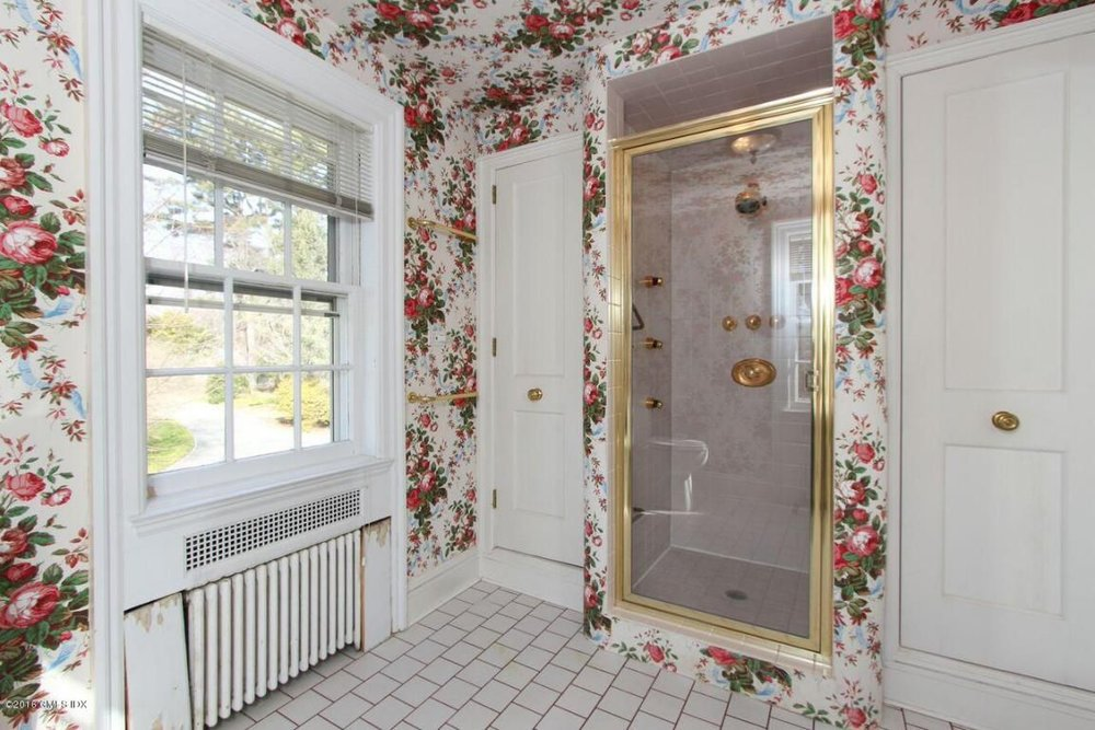 With any luck, you can at least replace the wallpaper and maybe even redo the shower