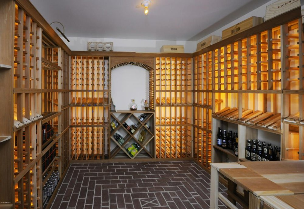 "Typical use of a typical ""wine cellar"": Quinine water, ginger ale, and a couple of cases of beer, canned and bottled. Why builders still include these space wasters eludes me"