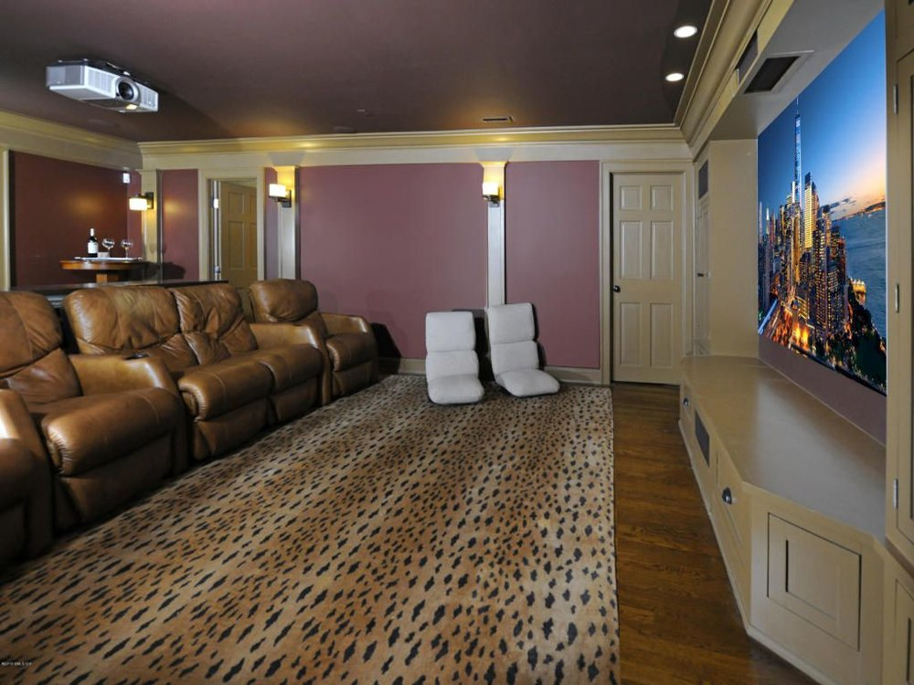 I DON'T THINK I'VE HAD A CLIENT IN THE PAST TEN YEARS WHO WAS IMPRESSED BY A HOME THEATRE, LEOPARD SKIN OR NOT — THEY SHOW THE SAME INDIFFERENCE TO COMFY CHAIRS IN THE BASEMENT AS THEY DO TO WINE CELLARS AND WHIRLPOOL BATHS