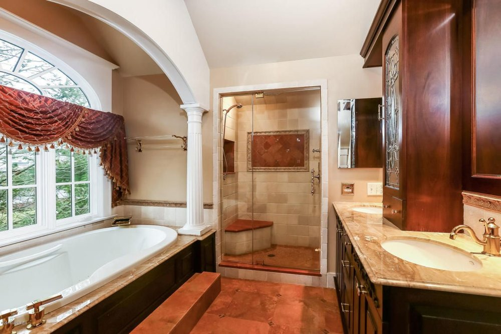 No to the pseudo-Roman bath, but the shower looks attractive