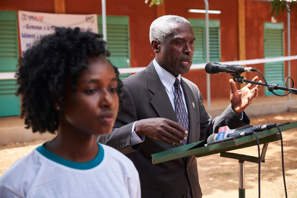 Former American Ambassador to Burkina Faso Dr. Tulinabo S. Mushingi speaks during the classroom opening ceremony.