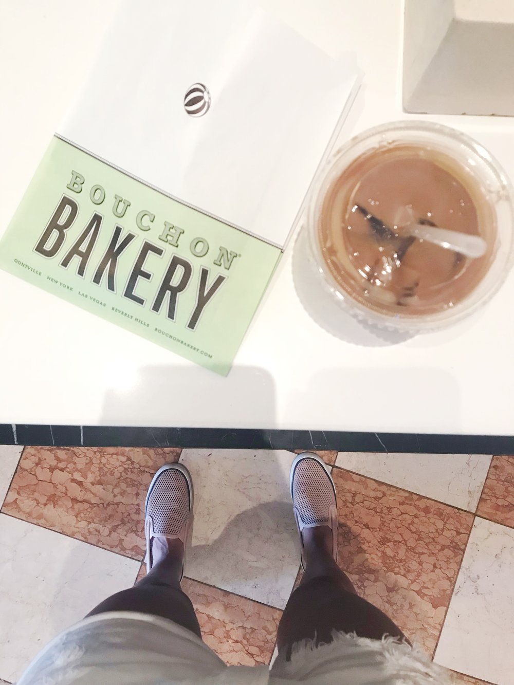 Grabbing some cold brew and a cookie at Bouchon Bakery