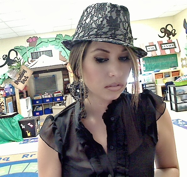 Sheer Blouse: My local Goodwill Hat: Forever 21 Earrings: $3.00 at a local discount store.