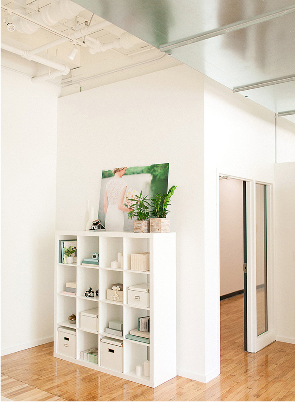 Bright white walls throughout.