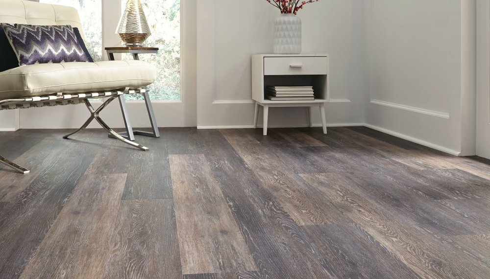 Click the image to see some of our vinyl plank options from Fuzion.
