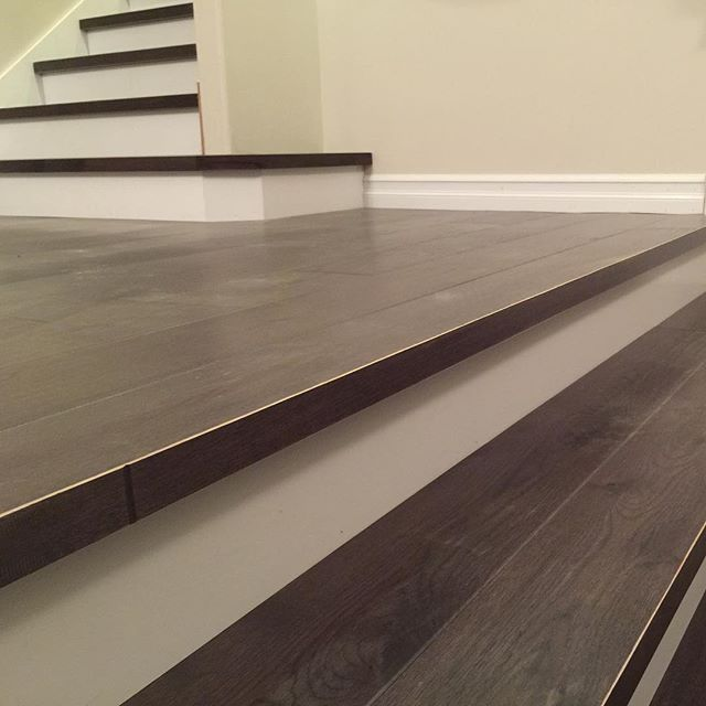 Custom stairs with square nose made from flooring. #handscrapedoak #customstairs #woodstairs #whiterisers