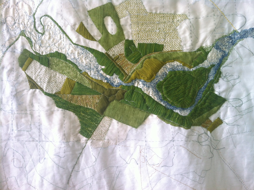 Work in progress in the Montreal studio, a detail of my map of Blönduós, stitches suggesting the dancing light on the blue River Blanda and the vivid green of Hrútey Island, centre-right. Certain fields are embroidered in krosssaumur, Iceland's long-armed cross-stitch. January 2017.