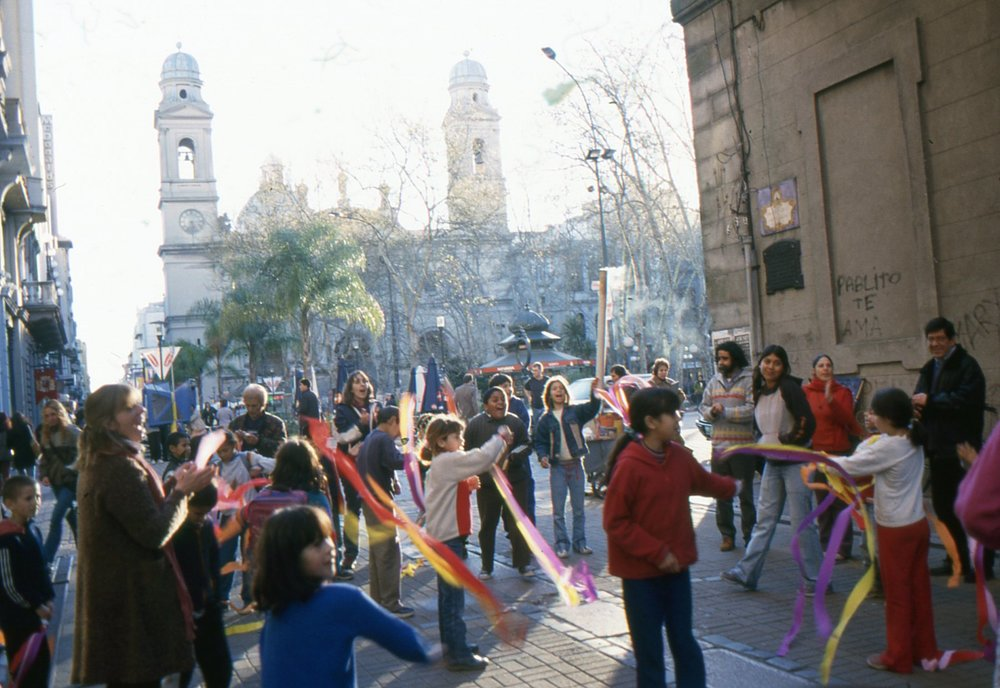 School children celebrate an election holiday on the edge of Plaza _Constitution. Iglisia Matriz lies across the square..jpg