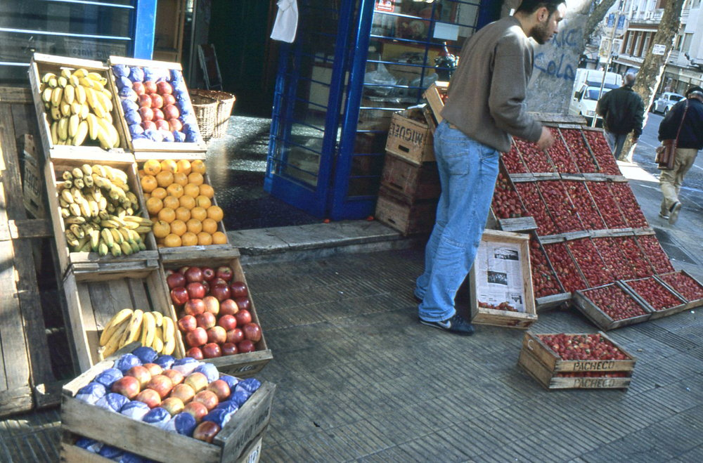 Uruguayans still prefer the corner grocery to supermarkets. Many small grocers display fruits and vegetables on the sidewalk outside.