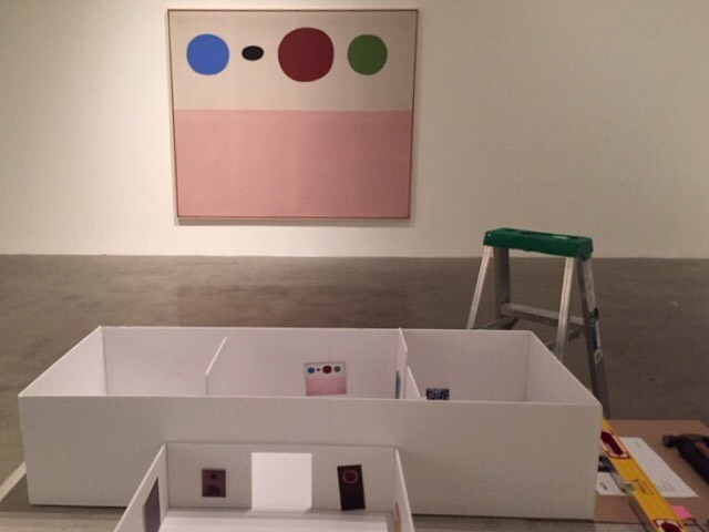 "Installation view showing the installation plan (foreground) and the painting LAKE, 1971, acrylic on canvas, 90 x 108""."