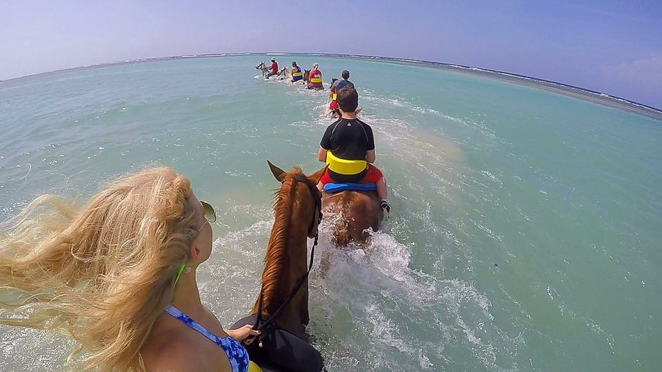 Riding horses in the ocean, yes please.