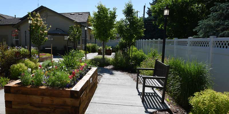 The Memory Care residence at The Gardens at Columbine offers a lodge-like setting with secure outdoor paths and gardens.