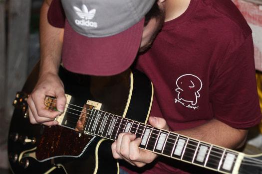 Guitarist Jack Ratajczak playing passionately.  Courtesy of Nosebleeds. Photo taken by Sara Soroko.