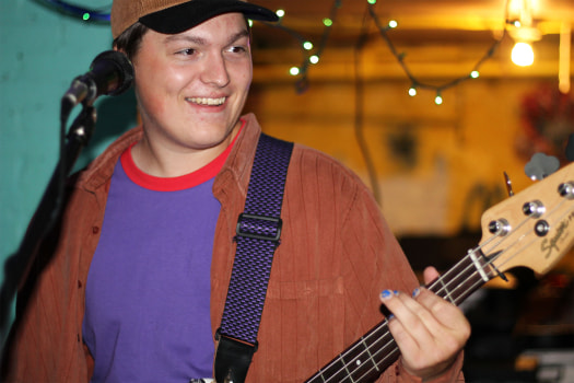 Bassist Mike Lynaugh laughing along with his bandmates.  Courtesy of Nosebleeds. Photo taken by Sara Soroko.