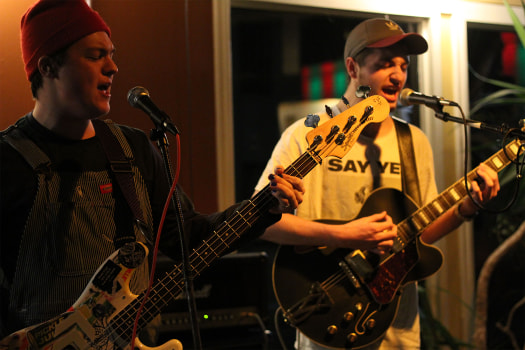 Mike Lynaugh (left) and Jack Ratajczak (right) playing together.  Courtesy of Nosebleeds. Photo taken by Sara Soroko.